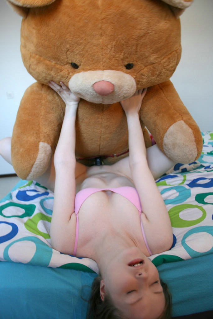 Women having sex with a teddy bear
